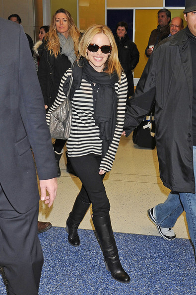 Kylie Minogue arrives at JFK International Airport in Queens as she prepares for her performance tomorrow at the Macy's Thanksgiving Day Parade.