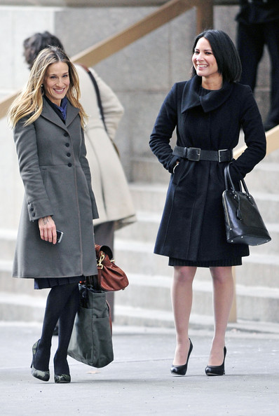 "Sarah Jessica Parker and Olivia Munn on day one of filming their new movie ""I Don't Know How She Does it"" on Wall Street which is an adaptation of Allison Pearson's comic novel about a business woman raising two children."