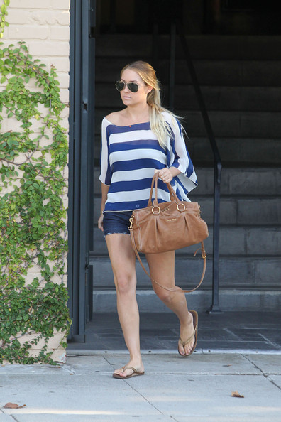"Lauren Conrad Lauren Conrad wears a blue and white striped top, jean shorts and carries a Miu Miu handbag as she leaves Kate Somerville skin care in Los Angeles. Conrad looks a bit more put together than yesterday's trip to the skin care experts as she Tweeted her embarrassment, ""Gym clothes, no makeup, wet hair and leaving a painful laser hair removal apt... This is exactly when I want to find 15 paps around my car."