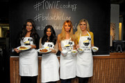 Lauren Goodger, Peri Sinclair, Lauren Pope, and Frankie Essex of 'The Only Way is Essex' (TOWIE) participate in a charity Cook-off held at the Waterhouse Restaurant in London.