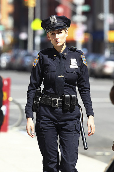 "LeeLee Sobieski wears an NYPD uniform as she shoots scenes for her latest project, ""Rookies,"" in NYC. The actress, wearing a 'Perry' name tag, shot several scenes out on a sidewalk with a male co-star."