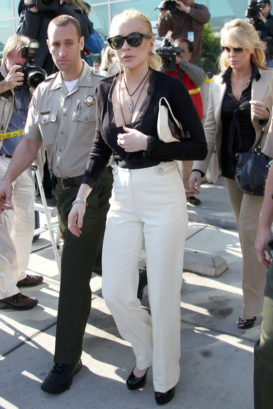 Lindsay Lohan Lindsay Lohan leaves the Airport Courthouse in Los Angeles, after facing the judge in her felony grand theft case. Judge Keith Schwartz told the troubled young actress that if she accepts a plea bargain, she will go to jail. It is being reported that Lohan has said she will not accept a plea and that she will go to trial.