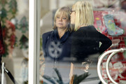 MOTHER-DAUGHTER BONDING: Tori and Candy Spelling catch a show at the Madrid Theater in Los Angeles together. Candy Spelling, seen munching a cookie, gets into a waiting vehicle as she says goodbye to Tori. The mother-daughter duo reconciled last year after putting reports of estrangement behind them.