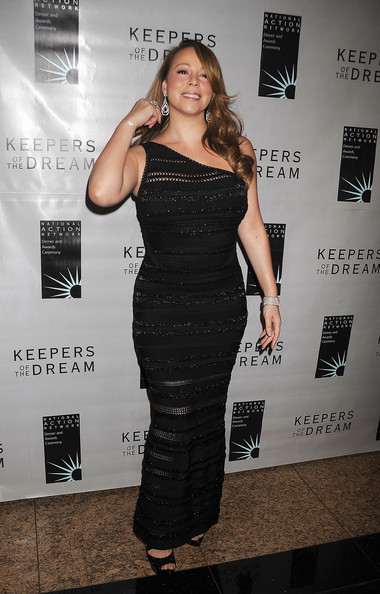 "Mariah Carey Mariah Carey at the 12th Annual Keepers Of The Dream Awards. Carey is seen wearing an off the shoulder black dress, showing off her curves. The singer was honored at the event as well as Wyclef Jean. The yearly four-day long fundraiser, ""recognizes exemplary displays of committed service to the tenets of Dr. Martin Luther King, Jr., the ultimate dreamer."
