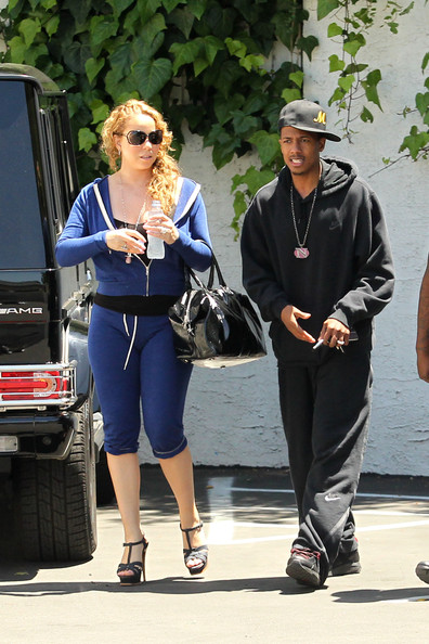 Mariah Carey Mariah Carey, wearing stiletto heels and blue sweats, is accompanied by husband Nick Cannon to a medical building in LA. The 40 year old singer recently renewed her wedding vows with Cannon in front of about 100 guests at their home in Beverly Hills on May 3rd.