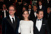 Director James Gray, Jeremy Renner and Marion Cotillard leaving 'the Immigrant' screening held at the Palais Des Festivals as part of the 66th Cannes Film Festival.