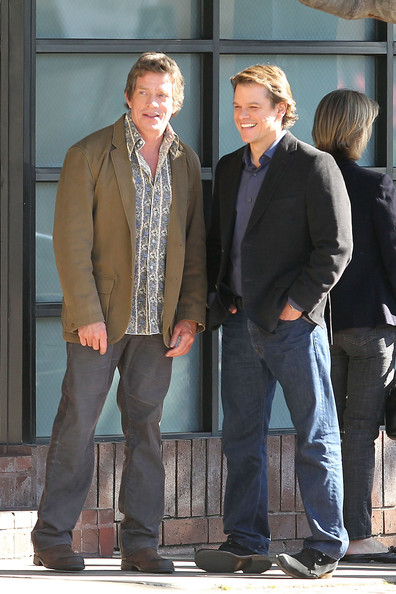 "Matt Damon and Thomas Haden Church share a laugh while waiting to film a scene for their new movie ""We Bought a Zoo"". In between takes, Damon could be seen holding a baby while talking with people on set."