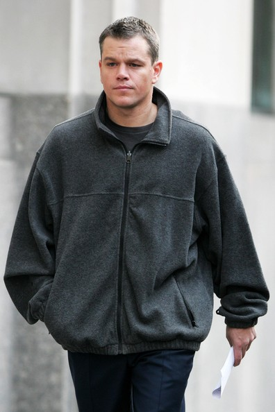 Matt Damon staying focused in a fleece sweater in between takes for his film