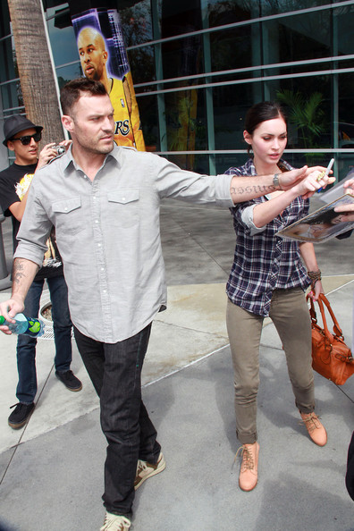 Megan Fox Brian Austin Green and wife Megan Fox are spotted leaving the Staples Center in Downtown Los Angeles after attending the Lakers basketball game. Brian could be seen ushering along Megan Fox as she was approached by autograph hunters while walking to their car.