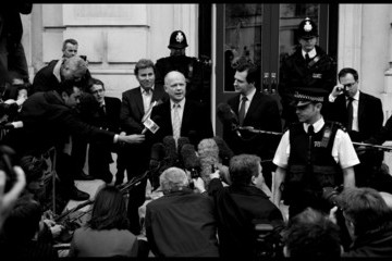 Mic William Hague and George Osborne leave the Cabinet office after talks with the Liberal Democrats on forming a coalition government