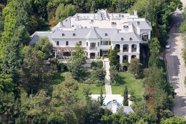 Michael Jackson FILE PHOTO dated Friday October 2 2009. The Holmby Hills mansion where Michael Jackson met his untimely death in June of 2009 has come back on the market with an asking price of $28,995,000. According to listing information the 17,171 square foot faux French chateau sits on a 1.26 acre lot and has a total of 7 bedrooms, 7 garages, 12 fireplaces, and 13 bathrooms. The Richard Landry designed dwelling on North Carolwood Drive is currently owned by Roxanne Guez and her  husband Hubert Guez, who is the current CEO of the clothing manufacturing company responsible for the obnoxious Ed Hardy brand.