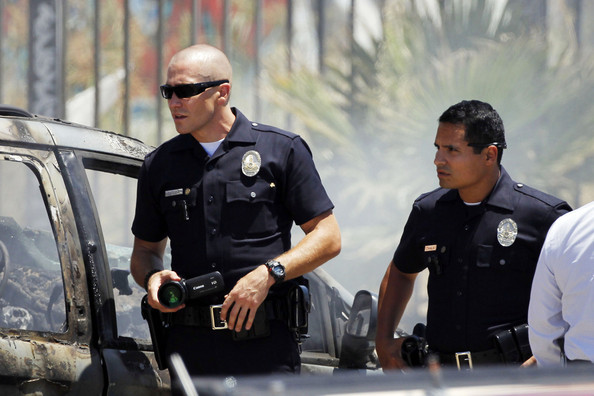 "Jake Gyllenhaal and Michael Pena are seen filming a scene of their new movie ""End of Watch"" in Los Angeles.  The two actors are seen in South Central Los Angeles filming near a burned down van.  Gyllenhaal, 30,  Is seen sporting a clean shaved head. ."