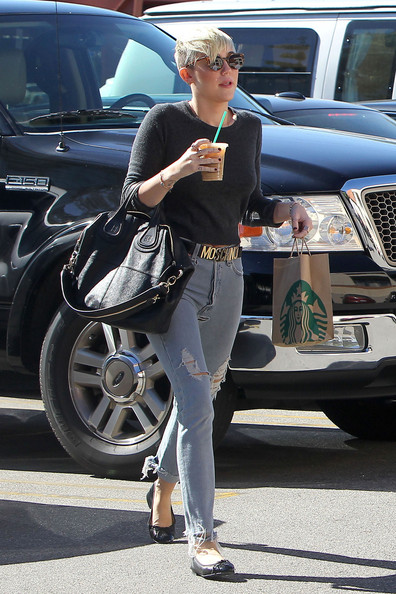 Miley Cyrus - Miley Cyrus and fiance Liam Hemsworth are spotted on a coffee date as the engaged couple stop off at their local Starbucks in LA