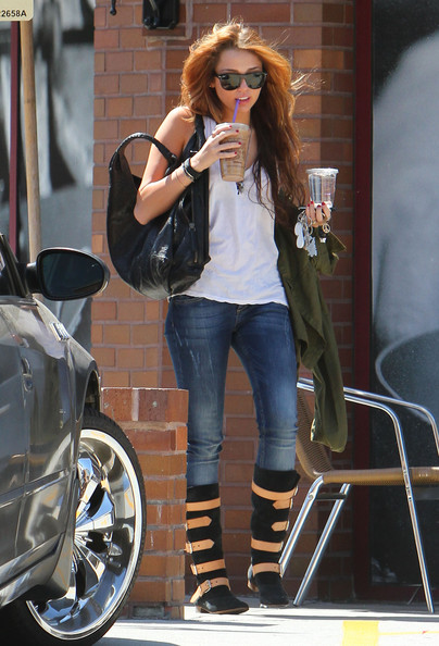 Miley Cyrus slurps on an iced beverage from Coffee Bean on a hot day in Los Angeles.