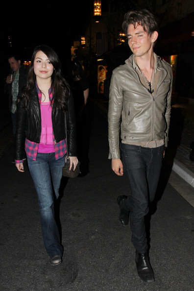 Miranda Cosgrove - Actress Miranda Cosgrove enjoys an evening out with a mystery male at The Grove in Los Angeles