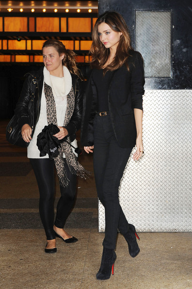 "Supermodel Miranda Kerr makes her way to MTV's ""It's On with Alexa Chung"" wearing Louboutin pumps and high waisted black denim jeans paired with a long silky blazer. Kerr just recently returned from Morocco with boyfriend, Orlando Bloom, for their Thanksgiving holiday."