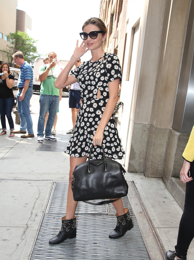 Miranda Kerr wears a daisy print dress and black motorcycle boots as she heads out around New York City.