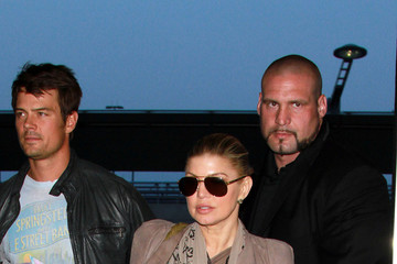 Pascal NEWS FLASH: Fergie and Josh Duhamel are seen departing from JFK airport with their bodyguard Pascal, who reportedly helped a sick passenger aboard the flight