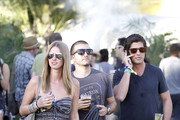 Nicky Hilton hangs out with boyfriend David Katzenberg (crew cut) and family friend Brandon Davis (black t-shirt) at the Coachella festival. Brandon didn't appear to be handling the desert heat too well, sporting big sweat marks under his armpits.