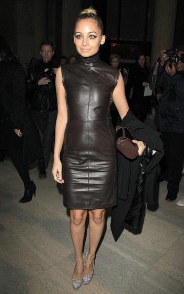 Nicole Richie dressed in a fabulous brown leather dress  joins a celebrity audience at the Givenchy Ready to Wear Autumn/Winter 2011/2012 show in Paris as part of Paris Fashion Week.