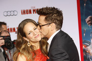 Robert Downey Jr. and Susan Downey at the Los Angeles premiere of 'Iron Man 3' held at the TCL Chinese Theater in Hollywood, Los Angeles.