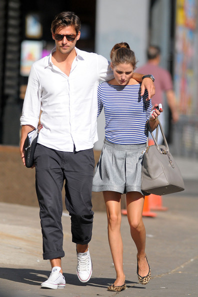Olivia Palermo and boyfriend Johannes Huebl are spotted strolling arm in arm in Soho. Palermo was seen wearing a blue and white striped top, leather skirt and animal print flats.