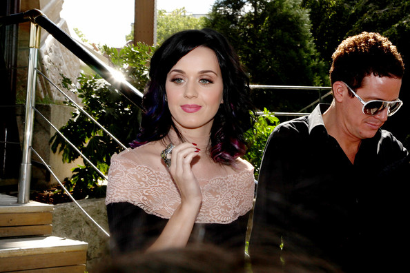 Ooh la la! Katy Perry is swamped by fans as she visits the Eiffel Tower in Paris.