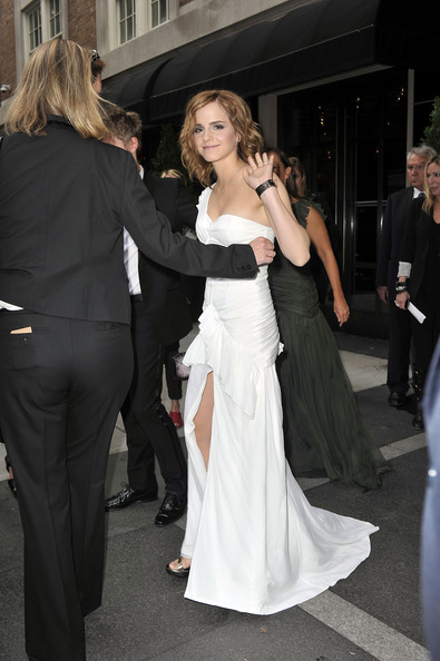 Emma Watson Emma Watson stops for a photograph as she makes her way from the Mark Hotel to the Costume Institute Gala at The Metropolitan Museum of Art in New York City.