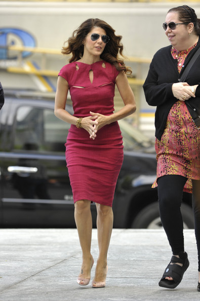 "Oscar-winning actress Marisa Tomei wears a cheery red dress for an appearance on ""The CBS Early Show"" in NYC."