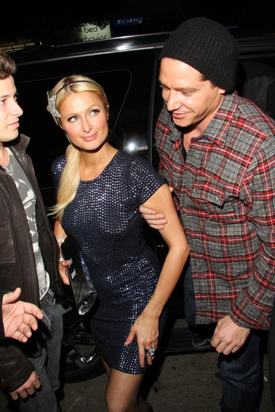 Paris Hilton Paris Hilton's boyfriend Cy Waits takes her by the arm as they arrive at Playhouse nightclub in LA.
