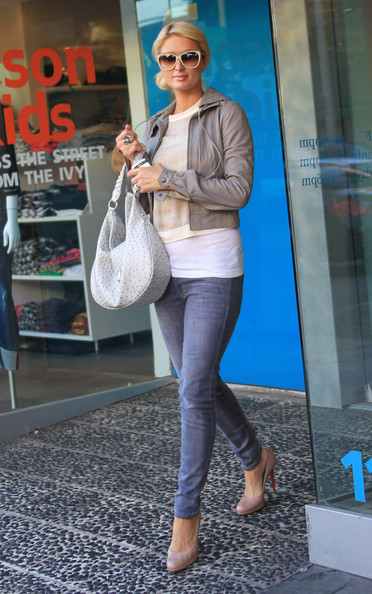 Paris Hilton A solo Paris Hilton goes on a shopping spree in the heart of Los Angeles. The heiress visited the three Kitson stores on Robertson Boulevard before climbing into her blue Bentley, making a u-turn and crossing a double yellow line.