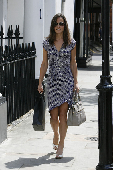 Perfect Pippa! Pippa Middleton looking chic in a wrap dress as she shops with a friend in London. The beauty caused quite a stir in the King's Road - with workmen stopping to get a good look at her famous figure.