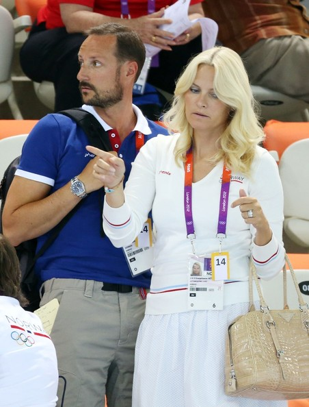 Prince Haakon of Norway and Princess Mette-Marit of Norway watch the swimming competition at the Aquatics Center of the Olympic Park. Summer Olympic Games 2012 in London.