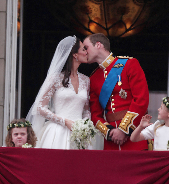 "Prince William Prince William and Catherine ""Kate"" Middleton now know as Duke & Duchess of Cambridge kiss from the balcony at Buckingham Palace after their marriage at Westminster Abbey which was watched by 2 billion people across the globe."