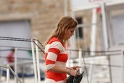Princess Beatrice and boyfriend Dave Clark seen enjoying a romantic holiday while boarding a boat with actress Holly Valance and fiance Nick Candy in Saint Tropez, France. The young Princess seemed relaxed and was laughing and joking with actress Holly while stroking boyfriend Dave's arms onboard the yacht.