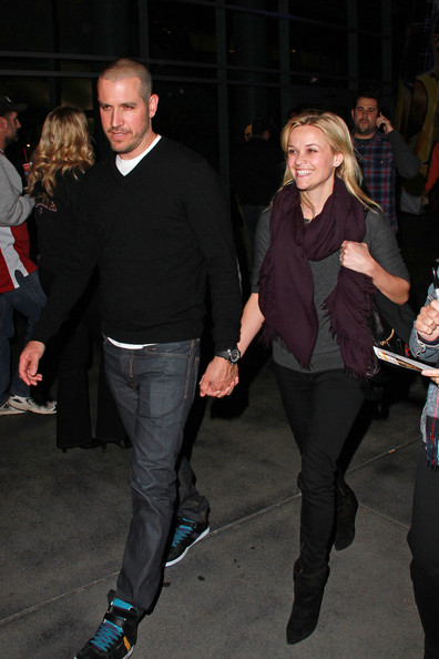 Reese Witherspoon A beaming Reese Witherspoon and her fiance Jim Toth leave