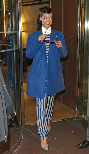 Rihanna Arrives in London