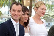 Jude Law, Martina Gusman, and Uma Thurman pose during a photocall for the Jury of the 64th Cannes Film Festival.