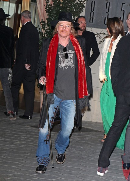Rocker Axl Rose former frontman of legendary band Guns N' Roses seen wearing some strange clothes and carrying a walking stick while leaving from the Sunset Towers in Hollywood.