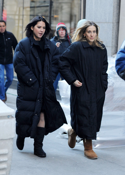 "Sarah Jessica Parker and Olivia Munn film a hectic scene on the set of ""I Don't Know How She Does It"" in lower Manhattan. Parker is seen rushing out of a building with two bags, and talking on her cell phone while looking up in another scene. The actress's character has the words 'bouncy house' written on her right hand."
