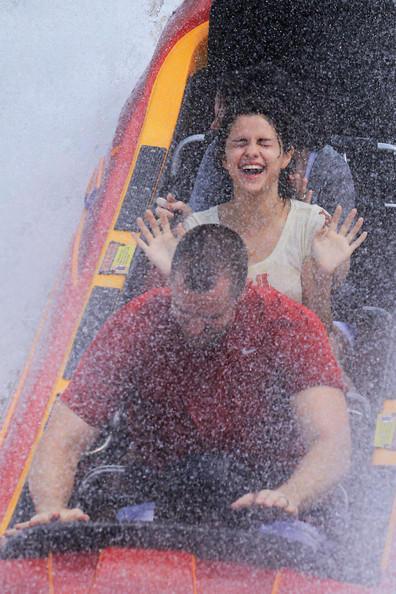 Selena Gomez Young actress Selena Gomez is seen having fun at Universal Studios in Florida.   Gomez smiles from ear to ear as she enjoys getting drenched in water.