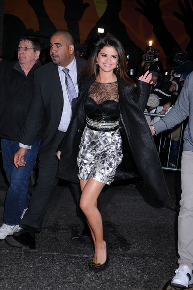 "Selena Gomez Selena Gomez poses for photographs outside of the Ed Sullivan Theatre after taping an appearance on ""The Late Show with David Letterman""."