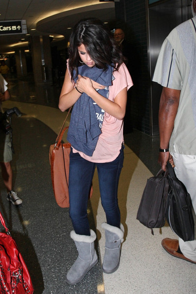 Selena Gomez takes a flight out of Tampa International Airport after filming scenes for her upcoming film