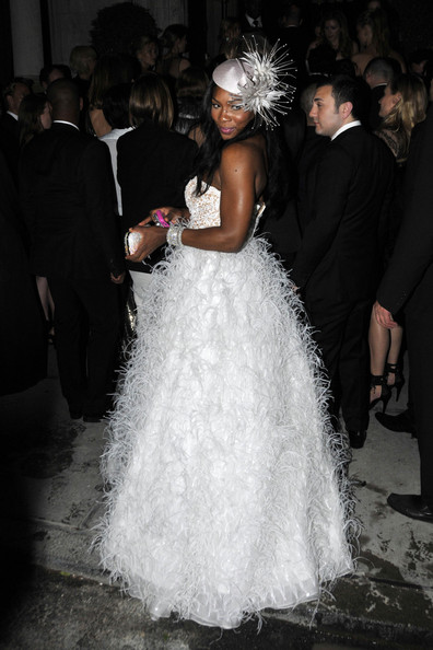 Serena Williams Serena Williams in an outrageous fluffy white dress at the Costume Institute Gala afterparty in New York.  The tennis star was head-to-toe in white feathers in the creation, which was designed by Oscar De La Renta.