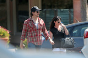 Shannen Doherty and her husband Kurt Iswarienko hold hands after grabbing some lunch in Malibu.