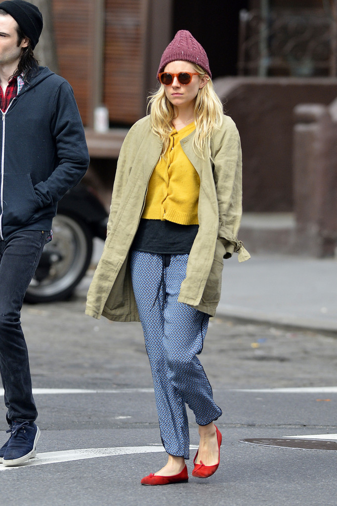 Sienna Miller walks around in the West Village in New York City.