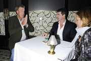 """Top Gear"" presenter Jeremy Clarkson chats to Simon Cowell as he smokes a cigarette enjoys a lager outside Scott's restaurant in London."