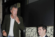 """Top Gear"" presenter Jeremy Clarkson chats to Simon Cowell as he smokes a cigarette and enjoys a lager outside Scott's restaurant in London."