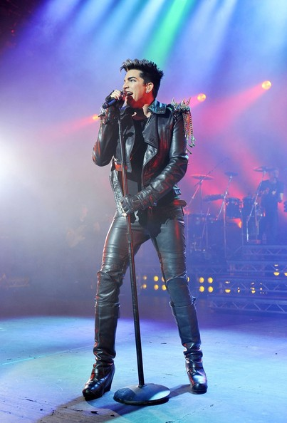 Singer Adam Lambert seen being joined on stage by Queen ...