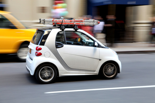 Smart Car With Roof Rack Carrying A Little Giant Step